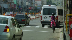 Girl on a bike looks for safety (PoAbikes12) Stock Footage