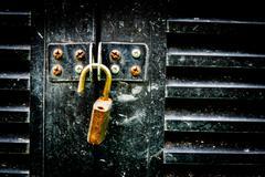 unlock on a dirty iron door - stock photo