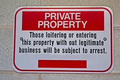 private property, message on stone wall - stock photo