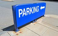 Stock Photo of blue parking sign on asphalt, modern transportation