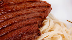 Food : pasta with tomato on basil and roasted sirloin beef Stock Footage