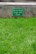 keep dogs off the grass, warning message - stock photo