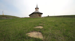 Stone stair in green field to lonely church Stock Footage
