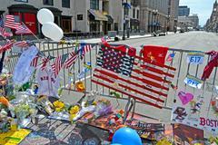 boston, flowers on memorial set up on boylston street in boston, usa. - stock photo