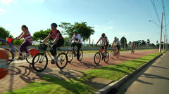 Vehicle shot of group of bikers on bike way - stock footage