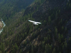 Aerial of plane flying over Rocky Mountains 01 - stock footage