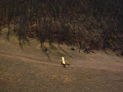 Aerial Plane taking off in back country 01 Stock Footage