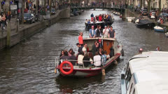 Party boat in the grachten of Amsterdam Stock Footage
