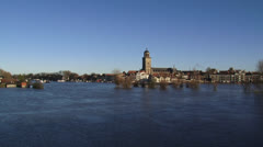 Skyline city of Deventer showing St. Lebuin's Church behind flooded river IJssel Stock Footage