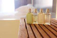 Four cosmetic bottles in a washroom Stock Photos