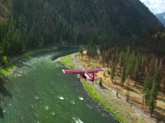 Aerial of plane flying over mountain river Stock Footage