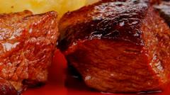 European food: roast beef meat goulash over red Stock Footage