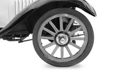 Vintage tire and wood rim  of old classic car Stock Photos