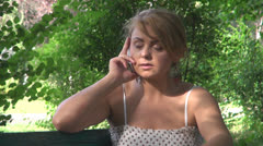 A nervous young woman talking on the cellphone - stock footage