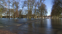 Flooded road + parking lot, due to high water level in river IJssel Stock Footage