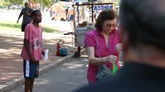 People tip poor singing boy at Porto Alegre's Flea Market (FleaMkt 48) Stock Footage