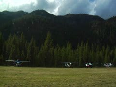 Johnson Creek Airstrip wide shot on runway 01 - stock footage