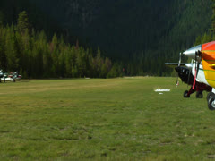 Johnson Creek Airstrip wide shot on runway 02 - stock footage