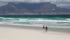 Two Men Enjoying Table Mountain View from Cape Town Beach Stock Footage