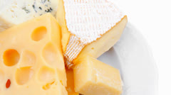 Parmesan and brie cheese on white platter Stock Footage