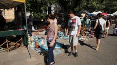 People look at vintage items at Porto Alegre's Flea Market (FleaMkt 19) Stock Footage