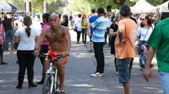 Biker and crowd at Porto Alegre's Flea Market (FleaMkt 45) Stock Footage