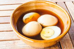 hard-boiled eggs stew with sweet gravy - stock photo