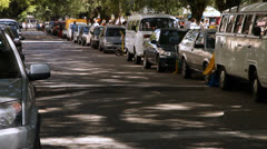 Parked cars on a street full of trees in Porto Alegre (FleaMkt 01) Stock Footage