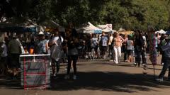 Shoppers and vendors walk at Porto Alegre's Flea Market (FleaMkt 06) Stock Footage