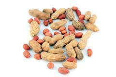 Peanuts mingle on white background. Stock Photos