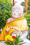 White stone buddha statue at temple Stock Photos