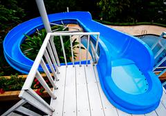 The water slide of pool in the forest Stock Photos