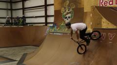Bmx downside footplant in skatepark Stock Footage