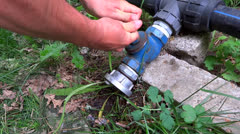 Person opening a valve Stock Footage