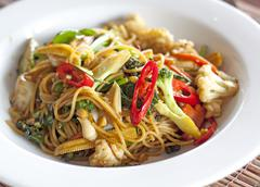 Spicy seafood spaghetti with many kind of herbs. Stock Photos
