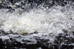 the water spread impact on water. - stock photo