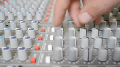 Turning aux knobs on sound board reup Stock Footage