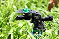 Focus the sprinkler on grass. Stock Photos