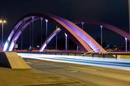 Pink road bridge at night Stock Photos