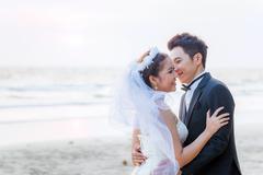 Wedding couple at beach Stock Photos