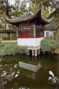ancient red pagoda reflection garden of the humble administrator suzhou china - stock photo