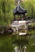 Stock Photo of ancient chinese pagoda reflection green willows garden of the humble administ
