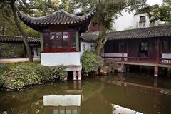 ancient red pagoda house reflection garden of the humble administrator - stock photo