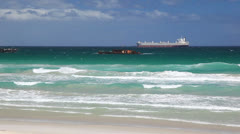 Cargo Ship Close to the Breaking Waves on the Beach Beach Stock Footage