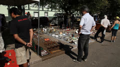 People look at vintage items at Porto Alegre's Flea Market (FleaMkt 34) Stock Footage