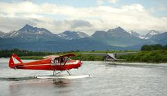 seaplane taxis takeoff lake hood ted stevens national airport anchorage - stock photo