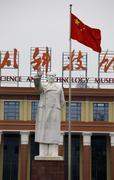Mao zedong statue red chinese flag tianfu square chengdu, sichuan, china Stock Photos