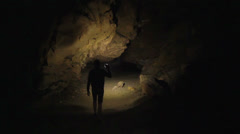 Cave explorer searching for a way out Stock Footage