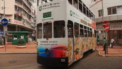 Movement of two-storeyed trams in Hong Kong. - stock footage