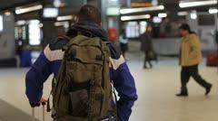 Man waiting at train station Stock Footage
